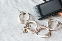 Bracelet, telephone and earrings Stock Image