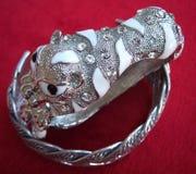 Bracelet tiger shape. On red background Stock Images