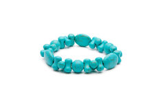 Bracelet from  turquoise stone isolated on a white Stock Photos