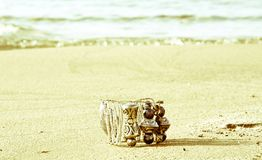 A bracelet typical of ancient Greece, lost on the beach. The beautiful Greece, the islands and the sea Royalty Free Stock Images