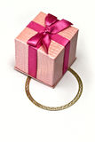 Bracelet under gift Stock Images