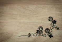 Bracelet vintage necklace on wooden table. retro filtered image Stock Photography