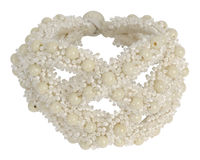 Bracelet from white beads. Isolated on a white background stock image