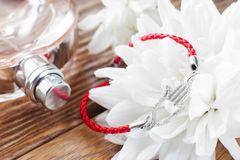 Bracelet on white flower and perfume background Royalty Free Stock Images