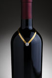 Bracelet on Wine Bottle Stock Images
