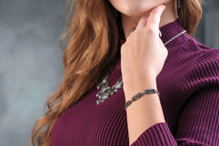 Bracelet on woman hand in focus. Close up female model wearing e Stock Image
