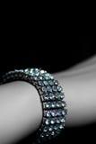 Bracelet on wrist C Stock Photos