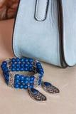 Bracelete, brincos e bolsa Imagem de Stock
