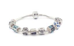 Bracelete de prata com os grânulos no branco Fotografia de Stock Royalty Free