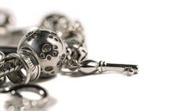Bracelete de prata do encanto Fotografia de Stock Royalty Free