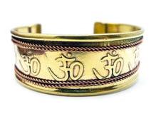 Bracelete do bronze do OM Fotos de Stock
