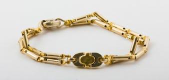 Bracelete do ouro Fotos de Stock Royalty Free