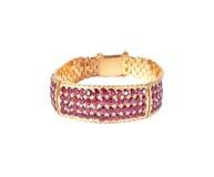 Bracelete do ouro com gemas do rubi Fotografia de Stock