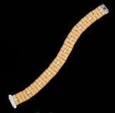 Bracelete dourado com diamantes Foto de Stock