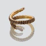 Bracelete dourado da mulher Fotografia de Stock Royalty Free