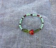 Bracelete vermelho do coração Foto de Stock