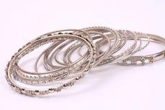 Bracelets 3. Many silver bracelets scattered around royalty free stock photo
