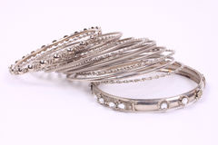Bracelets 4. Many silver bracelets ontop of eachother scattered around royalty free stock image