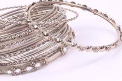 Bracelets. Many silver bracelets ontop of eachother stock photo