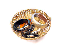 Bracelets in basket. Isolated on white background Stock Image