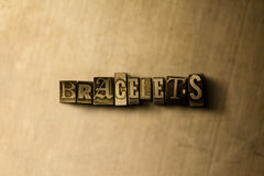 BRACELETS - close-up of grungy vintage typeset word on metal backdrop Stock Image
