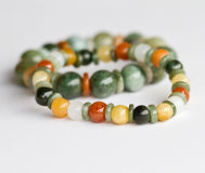 Bracelets. Colorful jade bracelets on white background royalty free stock image