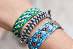 Bracelets. Colourful bangles around the wrist of a young boy Stock Images