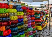 Bracelets display at street market stock images