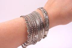 Bracelets on a hand Stock Photos