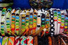 Bracelets. Handdmade textile bracelest exposed to stand store outdoor Stock Images