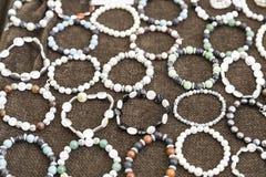 Bracelets handmade in a market Stock Images