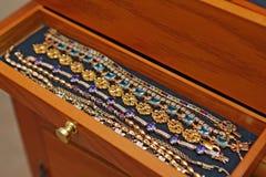 Bracelets in jewelry box Stock Photos