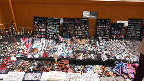 Bracelets, necklaces, earrings and souvenirs in Lima. Peruvian multicolored hand made bracelets, necklaces, earrings and souvenirs in different styles and colors stock image
