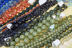 Bracelets and necklaces made of natural gems Stock Image