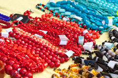 Bracelets and necklaces made of natural gems Royalty Free Stock Images