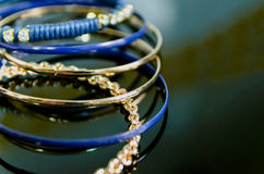 Bracelets. Some bracelets made of fake gold. Imitation jewelry Stock Images