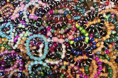 Many patterned beaded bracelet together royalty free stock photo