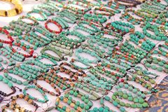Bracelets turquoise stone on the market in India, Anjuna. Gift souvenir India Tibet Bazaar royalty free stock photography