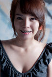 Braces asian girl portrait Stock Image