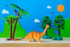 Brachiosaurus dinosaur toy model on wild models background. Closeup Royalty Free Stock Photos