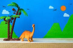 Brachiosaurus dinosaur toy model on wild models background. Closeup Stock Photo