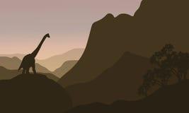 Brachiosaurus in hills silhouette scenery Stock Image