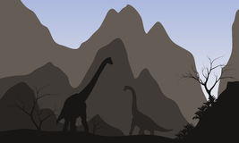 Brachiosaurus silhouette with mountain Royalty Free Stock Images