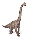 Brachiosaurusdinosaurieleksak som isoleras på vit bakgrund med den snabba banan fotografering för bildbyråer