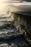 A Bracing Morning. Waves crash against the pier at Tynemouth on a windy September morning Stock Photos