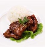 Braciola di maiale acida dolce con riso Immagini Stock
