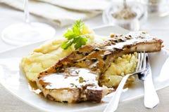 Braciola di maiale e purè di patate Fotografia Stock