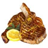 Braciole di maiale cotte con salvia ed il limone sopra bianco Fotografia Stock