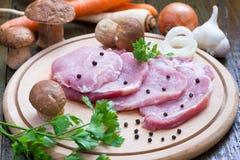 Braciole di maiale crude Fotografia Stock Libera da Diritti