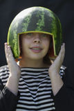 Bracket smiling girl holding melon hemlet Royalty Free Stock Images